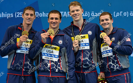(l-r) Coner Dwyer Ryan Lochte Matt Mcleanand and Tyler Clary of the Usa Celebrate on the Podium After Winning the Men's 4x200m Freestyle Final During the 12th Fina Short Course World Swimming Championships at Hamad Aquatic Centre in Doha Qatar 04 December 2014 Qatar Doha