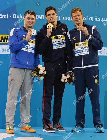 (l-r) Silver Medalist Marco Orsi of Italy Winner Florent Manaudou of France and Bronze Medalist Cielo Filho Cesar of Brazil Pose on the Podium After the Men's 50m Freestyle Final During the 12th Fina Short Course World Swimming Championships at Hamad Aquatic Centre in Doha Qatar 05 December 2014 Qatar Doha