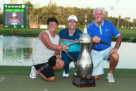 Rory Mcilroy of Northern Ireland Celebrates with His Mother Rosie Mcilroy and Father Gerry Mcilroy After Winning the Omega Dubai Desert Classic 2015 Golf Tournament at Emirates Golf Club in Dubai United Arab Emirates 01 February 2015 United Arab Emirates Dubai