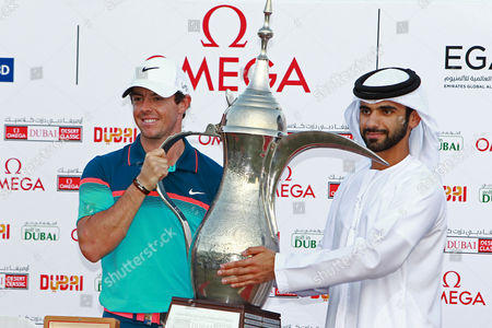 Rory Mcilroy of Northern Ireland is Presented with the Trophy by His Highness Sheikh Mansour Bin Mohammed Bin Rashid Al Maktoum During the Omega Dubai Desert Classic 2015 Golf Tournament at Emirates Golf Club in Dubai United Arab Emirates 01 February 2015 United Arab Emirates Dubai