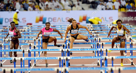 (l-r) Dawn Harper of the Us Kellie Wells of the Us Lolo Jones of the Us and Tiffany Porter of Great Britain Compete in the Women's 100m Hurdles Race at the Iaaf Diamond League Meeting in Doha Qatar 10 May 2013 Qatar Doha