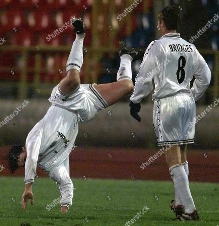 Moscow Russian Federation: Ian Harte (l) of Leeds United Goes Upside Down As He Celebrates the First Goal For His Team Scored by Michael Bridges (r) During Their Uefa Cup Match Against Lokomotive Moscow in Moscow Thursday 04 November 1999
