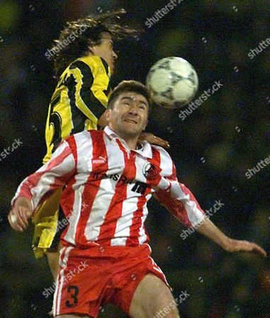 Moscow Russian Federation: Giuseppe Pancaro (rear) of Lazio and Yuri Drozdov of Lokomotiv Leap For a Ball During Their Cup Winners Cup Semi-final Match in Moscow on Thursday 08 April 1999
