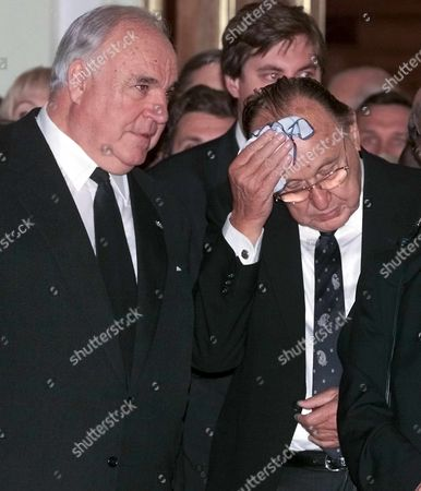 Stock Picture of Moscow Russian Federation : Former German Chancellor Helmut Kohl (c) and Former German Foreign Minister Hans-dietrich Gensher Attend the Funeral Ceremony of Raisa Gorbacheva at Russias Culture Fund in Moscow Thursday 23 September 1999 Raisa Gorbacheva Died on Monday Aged 67 in Muenster Germany where She Had Been Treated For Leukemia For Two Months