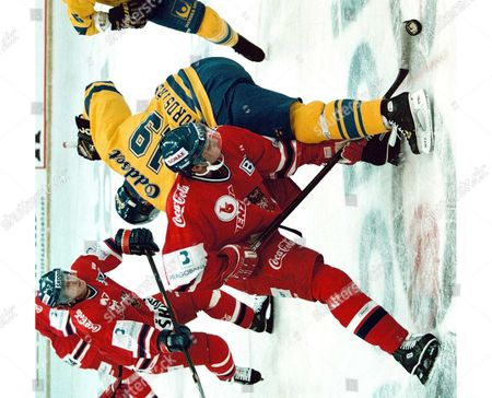 Czech Jan Alinc (l) Fights For the Puck with Swedish Peter Nordstrom (r) During Their Match at the 'Baltika Cup' International Ice Hockey Tournament in Moscow 18 December Russian Federation Moscow