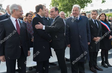 Stock Image of Claude Bartolone, Emmanuel Macron, Francois Hollande, Gerard Larcher, Nicolas Sarkozy and Anne Hidalgo.  French president-elect Emmanuel Macron and outgoing French President Francois Hollande attend a ceremony to mark the Western allies' World War Two victory in Europe