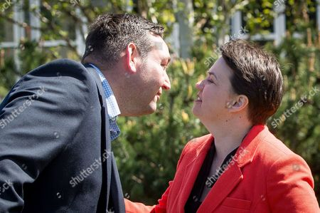 Miles Briggs, MSP, greets Ruth Davidson as see comes to the platform