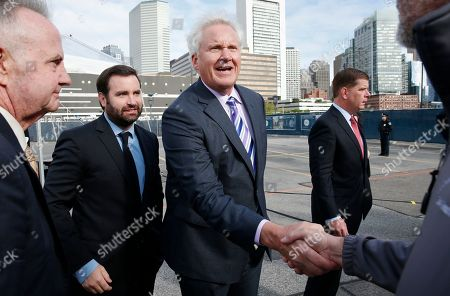 General Electric CEO Jeffrey R Immelt, center, greets construction workers following a ceremonial groundbreaking on the site of GE's new headquarters, in Boston