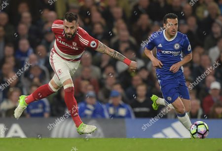 Pedro of Chelsea runs past Alvaro Negredo of Middlesbrough during the Premier League match between Chelsea and Middlesbrough played at Stamford Bridge, London on 8th May 2017
