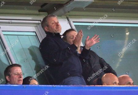 Stock Image of Chelsea owner Roman Abramovich applauds his team during the Premier League match between Chelsea and Middlesbrough played at Stamford Bridge, London on 8th May 2017