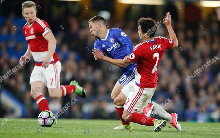 Chelsea's Eden Hazard, centre, vies for the ball with Middlesbrough's Fabio da Silva during the English Premier League soccer match between Chelsea and Middlesbrough at Stamford Bridge stadium in London
