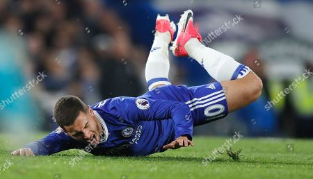 Chelsea's Eden Hazard falls after a tackle with Middlesbrough's Fabio da Silva during the English Premier League soccer match between Chelsea and Middlesbrough at Stamford Bridge stadium in London