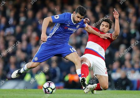 Chelsea's Diego Costa, left, vies for the ball with Middlesbrough's Fabio da Silva during the English Premier League soccer match between Chelsea and Middlesbrough at Stamford Bridge stadium in London