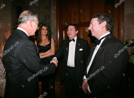 Prince Charles meets musician Jools Holland (centre) and televison presenters Carol Vorderman (left) and Eric Knowles