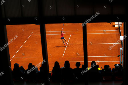 Samantha Stosur from Australia jumps to returns a ball against Mariana Duque-Marino from Colombia during a Madrid Open tennis tournament match in Madrid, Spain, . Stosur won 6-3 and 7-5
