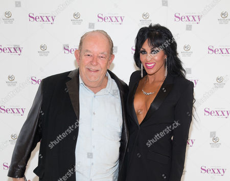 Stock Photo of Robin Leach and Jennifer Romas