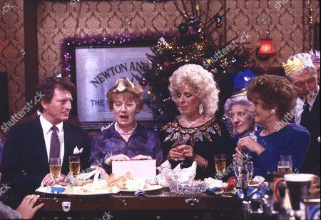 Hilda Ogden's leaving party. Johnny Briggs (as Mike Baldwin), Jean Alexander (as Hilda Ogden), Julie Goodyear (as Bet Gilroy), Jill Summers (as Phyllis Pearce) and Barbara Knox (as Rita Fairclough)