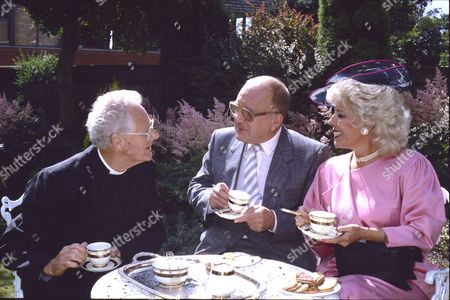 Stock Picture of Jeffery Gardiner (as Reverend Rawlinson), Roy Barraclough (as Alec Gilroy) and Julie Goodyear (as Bet Gilroy)