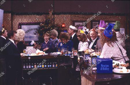 Hilda Ogden's leaving party. William Tarmey (as Jack Duckworth), Johnny Briggs (as Mike Baldwin), Julie Goodyear (as Bet Gilroy), Jean Alexander (as Hilda Ogden), Elizabeth Dawn (as Vera Duckworth), Jill Summers (as Phyllis Pearce), Barbara Knox (as Rita Fairclough), Tom Mennard (as Sam Tindall), Helen Worth (as Gail Tilsley), Bill Waddington (as Percy Sugden), William Roache (as Ken Barlow) and Anne Kirkbride (as Deirdre Barlow)