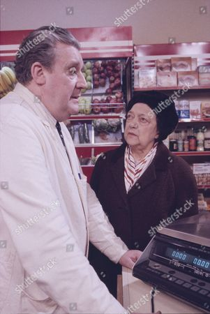 Stock Image of Bryan Mosley (as Alf Roberts) and Nellie Hanham (as Mrs Tattersall)