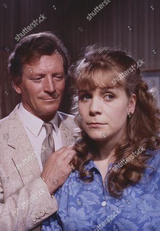 Stock Picture of Johnny Briggs (as Mike Baldwin) and Wendy Jane Walker (as Susan Baldwin)