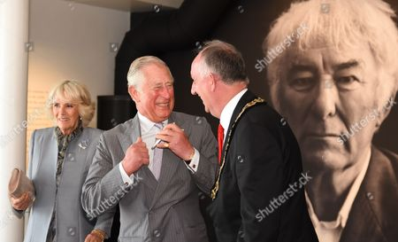 Stock Photo of Prince Charles and Camilla Duchess of Cornwall visit the Seamus Heaney HomePlace arts and literary centre in Bellaghy