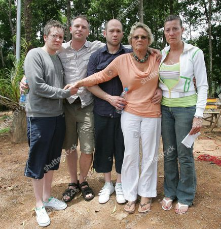 Linda Robertson with her children and her husband Malcolm's children shortly after they arrived in Thailand: Ben Trevett (34), Dean Robertson (37), Darren Trevett (37), Linda Robertson (58) and Tara Robertson (38)
