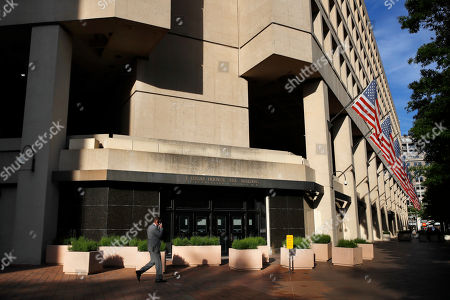 The J. Edgar Hoover FBI building on Pennsylvania Avenue in Washington, . President Donald Trump abruptly fired FBI Director James Comey Tuesday, ousting the nation's top law enforcement official in the midst of an investigation into whether Trump's campaign had ties to Russia's election meddling