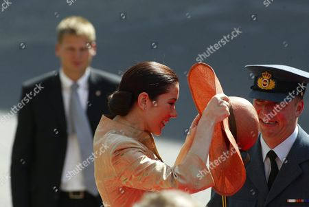 Mary Elizabeth Donaldson of Australia Puts on Her Hat After It Flew Off During a Gust of Wind Arriving at the Parliament in Copenhagen Thursday 13 May 2004 Miss Donaldson Will Marry Crown Prince Frederik in Copenhagen Cathedral Tomorrow Friday 14 May 2004 Man at Right is Unidentified Denmark Copenhagen