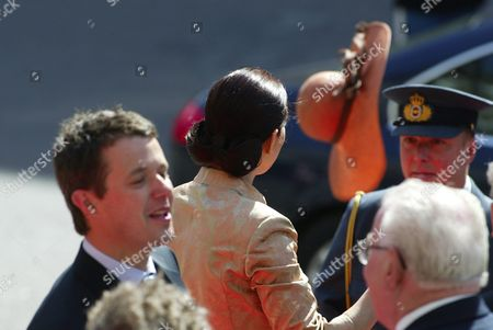 Mary Elizabeth Donaldson of Australia is Looking After Her Hat Which Flew Off During a Gust of Wind Arriving at the Parliament in Copenhagen Thursday 13 May 2004 Miss Donaldson Will Marry Crown Prince Frederik in Copenhagen Cathedral Tomorrow Friday 14 May 2004 Denmark K?benhavn