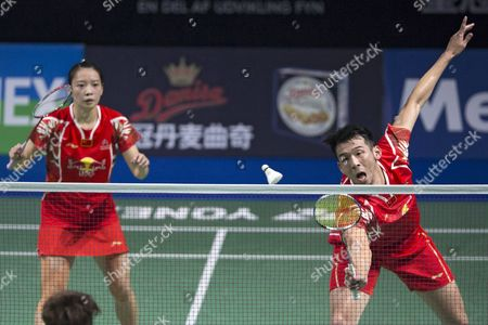 Huang Yaqiong (l) and Lu Kai (r) of China During Their Mixed Double Match Against Wang Yiliu and Huang Dongping of China in the Yonex Denmark Open Badminton Tournament in Odense Denmark 21 October 2016 Denmark Odense