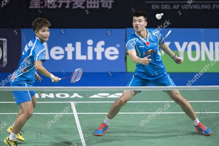 Huang Dongping (l) and Wang Yiliu (r) of China During Their Mixed Double Match Against Lu Kai and Huang Yaqiong in the Yonex Denmark Open Badminton Tournament in Odense Denmark 21 October 2016 Denmark Odense