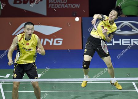 Nan Zhang and Yuniel Zhao of China in Action Against Sudket Prapakamol and Saralee Thoungthongkam From Thailand During the Mixed Doubles Quarter Final Match of the 2014 Bwf World Badminton Championships in Copenhagen Denmark 29 August 2014 Denmark Copenhagen