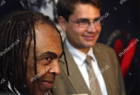 Brazilian Musician and Minister of Culture Gilberto Gil (l) is Appointed 'Hans Christian Andersen Ambassador' by His Danish Counterpart Brian Mikkelsen in Tivoli Gardens in Copenhagen Friday 09 July 2004 in Background is a Poster with a Portrait of the Famous Danish Fairy Story Teller Andersen Gilberto Gil is the 44th of Renowned International Icons to Be Appointed Hans Christian Andersen was Born on April 2 1805 His 200th Anniversary Will Be Celebrated World Wide Denmark Copenhagen