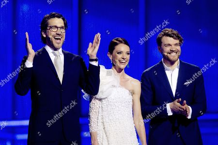 Stock Picture of Eurovision Hosts Nikolaj (l) Lise Roenne (c) and Pilou Asbaek Talk During Rehearsals For the First Semi-final of the 59th Annual Eurovision Song Contest at the B&w Hallerne in Copenhagen Denmark 05 May 2014 the Two Semi-finals Will Take Place on 06 and 08 May the Grand Final on 10 May Denmark Copenhagen
