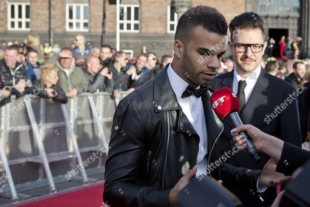 Hungarian Singer Andras Kallay-saunders Speaks to Reporters As He Arrives on the Red Carpet For the Opening Ceremony of Eurovision Song Contest 2014 in Copenhagen Denmark 04 May 2014 Andras Will Represent Hungary with the Song 'Rinning' at the 59th Annual Eurovision Song Contest the Two Semi-finals Will Take Place on 06 and 08 May the Grand Final on 10 May Denmark Copenhagen