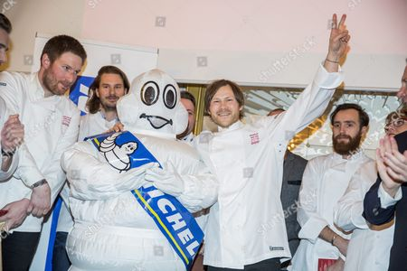 Chef of the Danish Restaurant Geranium Rasmus Kofoed (c) Celebrates with His Team After Receiving His Third Michelin Star During a Press Conference at Hotel D'angleterre in Copenhagen Denmark 24 February 2016 where the Michelin Guide Presented New Star Restaurants in Denmark and the Other Nordic Countries Denmark Copenhagen