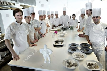 The Picture Dated 14 March 2013 Shows Danish Chef Rasmus Kofoed (l) and His Team in His Restaurant Geranium in Copenhagen Denmark Restaurant Geranium Received is Third Michelin Star During a Press Conference at Hotel D'angleterre in Copenhagen Denmark 24 February 2016 where the Michelin Guide Presented New Star Restaurants in Denmark and the Other Nordic Countries Denmark Copenhagen