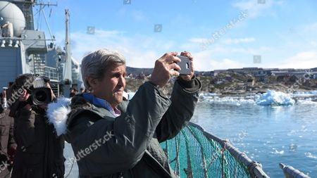 Stock Photo of Us Secretary of State John Kerry Taking a Photograph During a Tour to the Jakobshavn Glacier and the Ilulissat Icefjord Located 155 Miles (250 Km) North of the Arctic Circle in Ilulissat Greenland 17 June 2016 Kerry is in Denmark For a Two Days Visit Greenland Ilulissat
