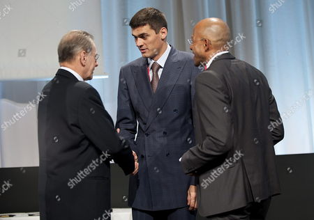 International Olympic Comittee (ioc) President Jacques Rogge (l) Greets Ioc Members Alexander Popov (c) and Frankie Fredericks (r) Before an Ioc Meeting in Copenhagen Denmark 07 October 2009 the Second Part of the Ioc Session Takes Part From 6th to 9th October Denmark Copenhagen