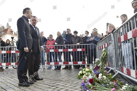 Danish Prime Minister Lars Loekke Rasmussen and the French Ambassador to Denmark Francois Zimeray Place Flowers in Front of the French Embassy in Copenhagen Denmark 14 November 2015 More Than 120 People Have Been Killed in a Series of Attacks in Paris on 13 November According to French Officials Denmark Copenhagen