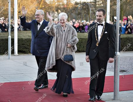 Danish Queen Margrethe (c) and Prince Consort Henrik (l) Wave As They Arrive For a Festive Evening at the Concert Hall in Aarhus Denmark 08 April 2015 As a Prelude to the Celebration of Margrethe's 75th Birthday on 16 April on the Right Aarhus Mayor Jacob Bundsgaard who Welcomed the Royal Couple on the Red Carpet Denmark Aarhus