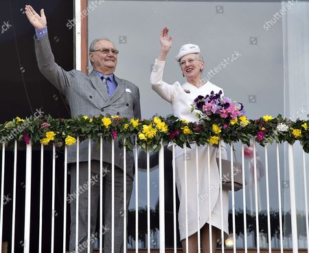 Danish Queen Margrethe (r) and Prince Consort Henrik Wave From the Balcony of the City Hall in Aaarhus Denmark 08 April 2015 As a Prelude to the Celebration of Queen Margrethe's 75th Birthday on 16 April Denmark Aarhus