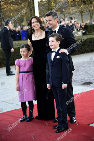 Stock Image of Danish Crown Prince Frederik (2-r) and Crown Princess Mary (2-l) Pose For a Family Picture As They Arrive on the Red Carpet with Their Children Prince Christian (r) and Princess Isabell (l) For a Festive Evening at the Concert Hall in Aarhus Denmark 08 April 2015 As a Prelude to the Celebration of Danish Queen Margrethe's 75th Birthday on 16 April on the Right Aarhus Mayor Jacob Bundsgaard who Welcomed the Royal Couple on the Red Carpet Denmark Aarhus