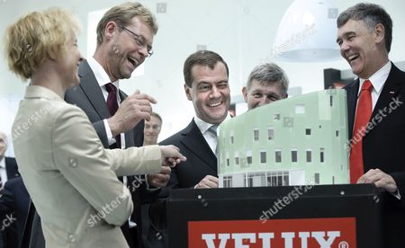 Russian President Dmitry Medvedev (c) Shares a Laugh with Danish Climate Minister Lykke Friis (l) Cowi Consult Ceo Lars Peter Soeby (2-l) Ralf Hemmingsen (2-r) Chamberlain of Copenhagen University and Velux Ceo Jorgen Tang-jensen (r) While Looking at the Model of a House with Velux Windows During His Visit to the Green Light House the First Co2 Neutral House in Denmark at Copenhagen University Denmark 28 April 2010 the Danish Company Velux is a Leading Global Producer of Skylights and Blinds Mevedev is on a Two-day Official Visit in Denmark Denmark Copenhagen
