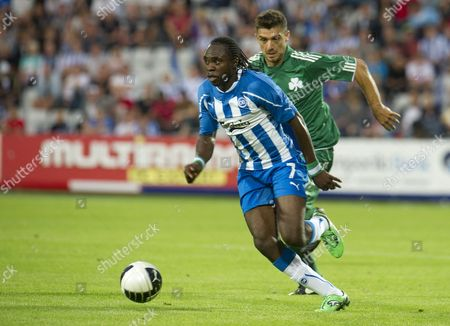 Peter Utaka of Ob Odense (l) Escapes Giourkas Seitaridis of Panathinaikos Fc During the Uefa Champions League 3rd Round Qualification Match Wednesday July 27 2011 at Fionia Park Stadium in Odense Denmark Denmark Odense