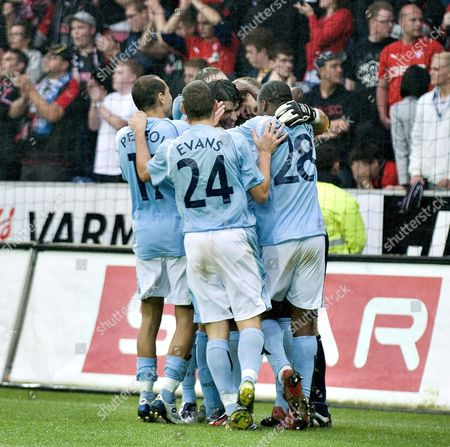 Stock Picture of Martin Petrov (l) Chedwyn Evans (24) and Daniel Sturridge (28) of Manchester City Celebrate Defeating Danish Team Fc Midtjylland After a Penanty Shoot out During Their Uefa Cup Second Round Second Leg Qualification Soccer Match at the Sas Arena in Herning Western Denmark on 28 August 2008 Denmark Herning