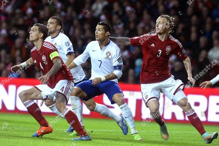 Portugal's Cristiano Ronaldo (c) in Action Against Danish Players Daniel Agger (l) and Simon Kjaer (r) During the Uefa Euro 2016 Qualifying Soccer Match Between Denmark and Portugal at Parken Stadium in Copenhagen Denmark 14 October 2014 Portugal Won 1-0 Denmark Copenhagen