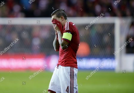 Denmark's Daniel Agger Reacts After the Uefa Euro 2016 Qualifying Soccer Match Between Denmark and Portugal at Parken Stadium in Copenhagen Denmark 14 October 2014 Denmark Lost the Match 0-1 Denmark Copenhagen