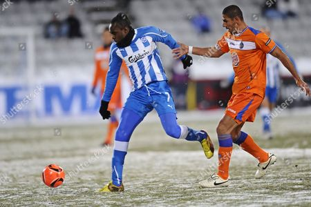 Getafe's Cata Diaz (r) Vies For the Ball with Odense Bk's Peter Utaka (l) During Their Uefa Europa League Group H Soccer Match in Odense Denmark 01 December 2010 Denmark Odense
